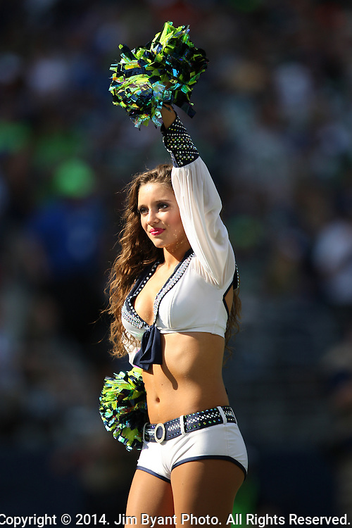 Seattle Seahawks,  Seagals  Cheer Squard, perform during the game against the  Denver Broncos at CenturyLink Field in Seattle, Washington on September 21, 2014. The Seahawks won 26-20 in overtime.    ©2014. Jim Bryant Photo. All rights Reserved.