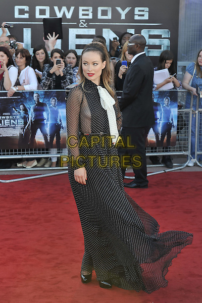 Olivia Wilde.UK Premiere of 'Cowboys and Aliens' at the Cineworld cinema at the O2 Arena, London, England..August 11th 2011.full length black white pussybow sheer polka dot dress side panel hairband  .CAP/MAR.© Martin Harris/Capital Pictures.