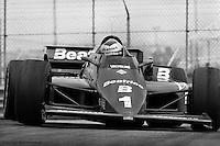 EAST RUTHERFORD, NJ - JUNE 30: Mario Andretti drives his Lola T900/Cosworth during the Meadowlands U.S. Grand Prix IndyCar race on June 30, 1985, on the temporary street circuit at the Meadowlands Sports Complex in East Rutherford, New Jersey.