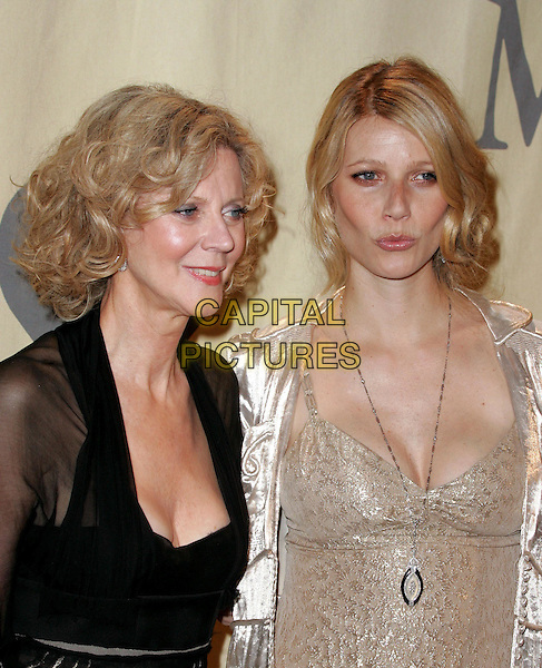 """BLYTHE DANNER & GWYNETH PALTROW.Attend """"A Family Affair: Women in Film celebrates The Paltrow Family"""" 2004 Crystal & Lucy Awards held at The Westin Century Plaza Hotel in Century City, California.June 18, 2004.half length, half-length, mother, daughter, family, necklace, pendant, jewellery, cleavage, lips, puckering.www.capitalpictures.com.sales@capitalpictures.com.©Debbie VanStory/Capital Pictures.."""