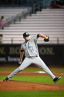Kane County Cougars pitcher Ryan Burr (33) delivers a pitch during a game against the Cedar Rapids Kernels on August 18, 2015 at Perfect Game Field in Cedar Rapids, Iowa.  Kane County defeated Cedar Rapids 1-0.  (Mike Janes/Four Seam Images)