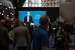 © Joel Goodman - 07973 332324 . 02/10/2017. Manchester, UK. Delegates watch Chancellor PHILIP HAMMOND deliver his keynote speech on a big screen in the exhibition hall , during the second day of the Conservative Party Conference at the Manchester Central Convention Centre . Photo credit : Joel Goodman