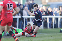 Peter Lydon of London Scottish is tackled during the Greene King IPA Championship match between London Scottish Football Club and Jersey at Richmond Athletic Ground, Richmond, United Kingdom on 18 February 2017. Photo by David Horn / PRiME Media Images.
