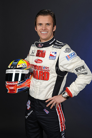 IndyCar driver Dan Wheldon has died from injuries after his car went sailing through the air during a massive 15-car wreck on the 11th lap of the Las Vegas Indy 300 on October 16, 2011. He was 33. HOMESTEAD, FL - FEBRUARY 24 : Indy Race League Driver Dan Wheldon poses for a portrait during IRL photo day at Homestead Miami Speedway on February 24, 2009 in Homestead, Florida. ( Credit Larry Marano (C) 2009)