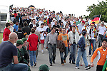 09 June 2006: A large crowd heads over the bridge from the subway station towards the stadium before the game. Germany played Costa Rica at the Allianz Arena in Munich, Germany in the opening match, a Group A first round game, of the 2006 FIFA World Cup.