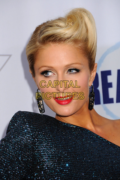 PARIS HILTON.2009 Fox Reality Channel Really Awards held at the Music Box Theatre, Hollywood, California, USA..October 13th, 2009.headshot portrait blue teal one shoulder sleeve beads beaded sparkly red lipstick updo up do hair up coif dangling black earrings structured shoulder pad.CAP/ADM/BP.©Byron Purvis/AdMedia/Capital Pictures.