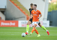 Blackpool's Jordan Thompson under pressure from Macclesfield Town's Jacob Blyth<br /> <br /> Photographer Kevin Barnes/CameraSport<br /> <br /> The Carabao Cup First Round - Blackpool v Macclesfield Town - Tuesday 13th August 2019 - Bloomfield Road - Blackpool<br />  <br /> World Copyright © 2019 CameraSport. All rights reserved. 43 Linden Ave. Countesthorpe. Leicester. England. LE8 5PG - Tel: +44 (0) 116 277 4147 - admin@camerasport.com - www.camerasport.com
