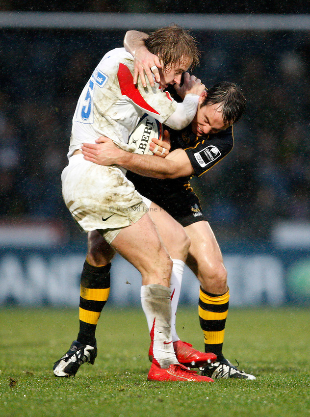 Photo: Richard Lane/Richard Lane Photography..London Wasps v Newcastle Falcons. EDF Energy Cup. 01/12/2007. .Falcons' Mathew Tait is tackled by Fraser Waters.