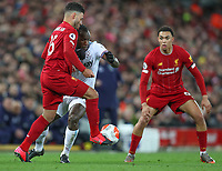 24th February 2020; Anfield, Liverpool, Merseyside, England; English Premier League Football, Liverpool versus West Ham United; Michail Antonio of West Ham United is tackled by Alex Oxlade-Chamberlain of Liverpool  as Trent Alexander-Arnold of Liverpool looks on