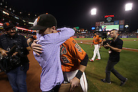 SAN FRANCISCO, CA - OCTOBER 2:  Matt Duffy #5 of the San Francisco Giants hugs his father Tom Duffy on the field after ceremonies honoring Duffy for winning the Willie Mac Award, named after former Giants great Willie McCovey, before the game against the Colorado Rockies at AT&T Park on Friday, October 2, 2015 in San Francisco, California. Photo by Brad Mangin
