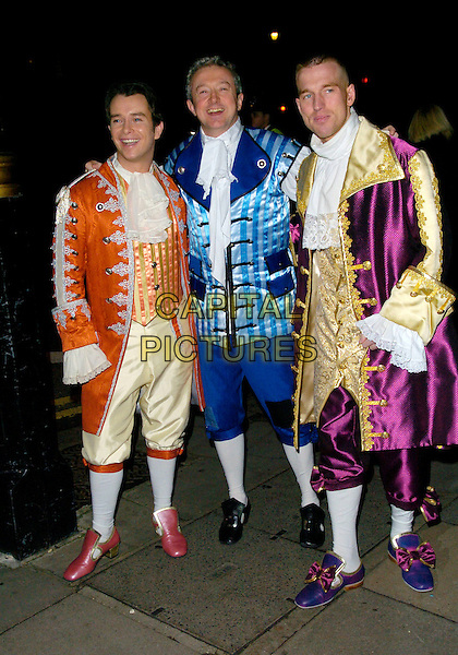STEPHEN GATELY, LOUIS WALSH & GUEST.Arrive at the pantomime themed fancy dress party reception for Matt Lucas & Kevin McGee following their civil partnership ceremony (wedding) earlier the same day, Banquetting House, Whitehall, London, England, .17th December 2006..full length costumes gatley .CAP/CAN.©Can Nguyen/Capital Pictures