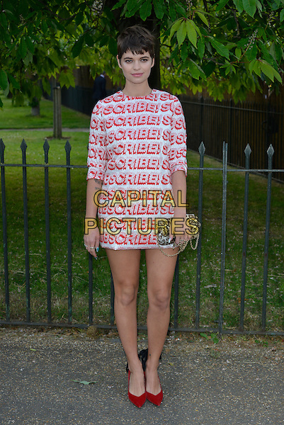 Pixie Geldof<br /> Serpentine Gallery Summer Party, Kensington Park Gardens, London, England.<br /> 26th June 2013<br /> full length scribble writing red white dress leopard print clutch bag shoes <br /> CAP/PL<br /> &copy;Phil Loftus/Capital Pictures