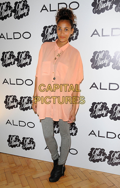Robyn Bright .At the Aldo a/w 2011 collection party, One Marylebone, London, England, UK .21st June 2011..full length peach shirt top black and white gingham checked trousers  leggings  ankle boots .CAP/CAN.©Can Nguyen/Capital Pictures.