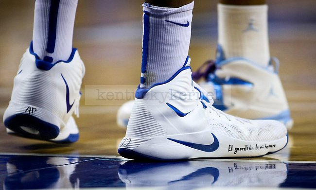 "Kentucky freshman Karl-Anthony Towns wrote ""My brothers keeper,"" ""AP,"" and ""22"" on his shoes to honor his teammate Alex Poythress during the University of Kentucky men's basketball game vs. University of North Carolina at Rupp Arena in Lexington , Ky., on Saturday, December 13, 2014. Kentucky won 84 - 70 over North Carolina Photo by Jonathan Krueger 