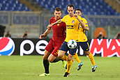 12th September 2017, Stadio Olimpic, Rome, Italy; UEFA Champions League between AS Roma versus Club Atletico de Madrid  Diego Godin challenged by  Dzeko ; the game ended on a 0-0 draw