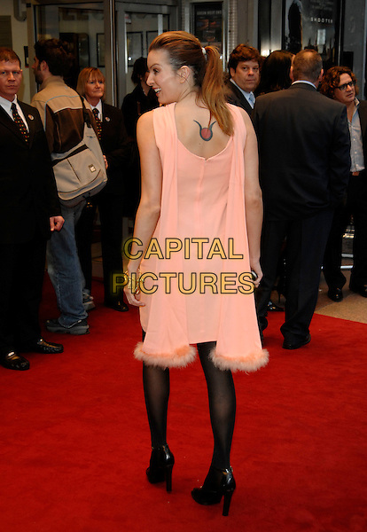 "CATALINA GUIRADO.Attending the UK Premiere of ""Shooter"", Odeon West End, London, England. .March 29th 2007.full length peach orange dress black tights back behind rear tattoo .CAP/PL.©Phil Loftus/Capital Pictures"
