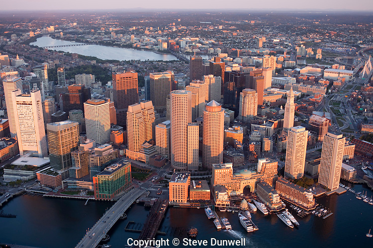 Boston skyline aerial sunrise view from harbor, Boston, MA