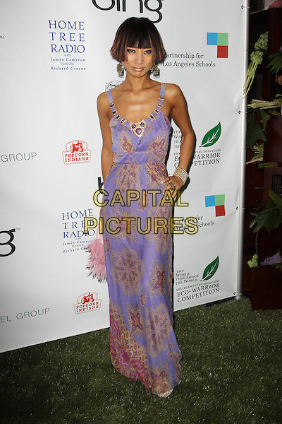 BAI LING .40th Annivesary of Earth Day held At The JW Marriott LA Live, Los Angeles, California, USA, 22nd April 2010..full length purple lilac long maxi dress print hand on hip .CAP/ADM/KB.©Kevan Brooks/AdMedia/Capital Pictures.