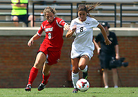 WINSTON-SALEM, NORTH CAROLINA - September 01, 2013:<br /> Shannon Dennehey (6) of Louisville University grabs at Ally Berry(8) of Wake Forest University during a match at the Wake Forest Invitational tournament at Wake Forest University on September 01. The match was abandoned early in the second half due to severe weather with Wake leading 1-0.