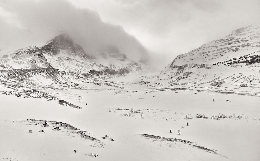 The wind whips fiercely through the mountains and valleys of Jasper National Park during a winter storm.