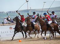 Action during the Wales v England match at the Asahi Beach Polo Championship  at Sandbanks, Poole, England on 10 July 2015. Photo by Andy Rowland.