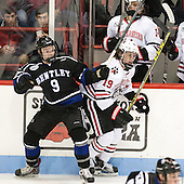 Ryan McMurphy (Bentley - 9), Lincoln Griffin (NU - 19) - The visiting Bentley University Falcons defeated the Northeastern University Huskies 3-2 on Friday, October 16, 2015, at Matthews Arena in Boston, Massachusetts.