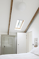 Skylights have been introduced into the roof space bathing the bedrooms in a soft light