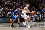 Dinos Mitoglou (44) of the Wake Forest Demon Deacons is guarded by Justise Winslow (12) of the Duke Blue Devils during first half action at the LJVM Coliseum on January 7, 2015 in Winston-Salem, North Carolina.  The Blue Devils defeated the Demon Deacons 73-65.  (Brian Westerholt/Sports On Film)