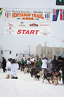 Ramey Smyth and team leave the ceremonial start line at 4th Avenue and D street in downtown Anchorage during the 2013 Iditarod race. Photo by Jim R. Kohl/IditarodPhotos.com