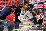 Volunteers wrap thousands of gifts during the 11th annual Holiday with a Hero at Walmart in Carson City, Nev., on Wednesday, Dec. 16, 2015. <br /> Photo by Cathleen Allison