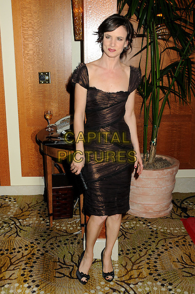 "JULIETTE LEWIS.9th Annual AARP Magazine ""Movies For Grownups"" Awards Gala held at The Beverly Wilshire Hotel, Beverly Hills, California, USA..February 16th, 2010.full length brown dress black clutch bag peep toe shoes wrap.CAP/ADM/BP.©Byron Purvis/AdMedia/Capital Pictures."