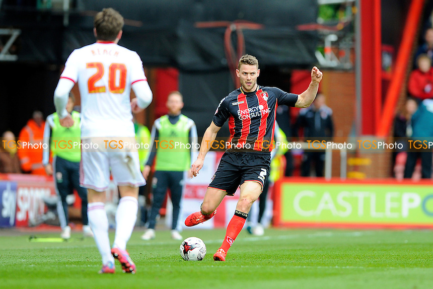 Simon Francis of AFC Bournemouth looks to play a pass out of defence - AFC Bournemouth vs Middlesbrough - Sky Bet Championship Football at the Goldsands Stadium, Bournemouth, Dorset - 21/03/15 - MANDATORY CREDIT: Denis Murphy/TGSPHOTO - Self billing applies where appropriate - contact@tgsphoto.co.uk - NO UNPAID USE