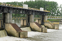 A dam  to regulate the water level for shipping and power generation