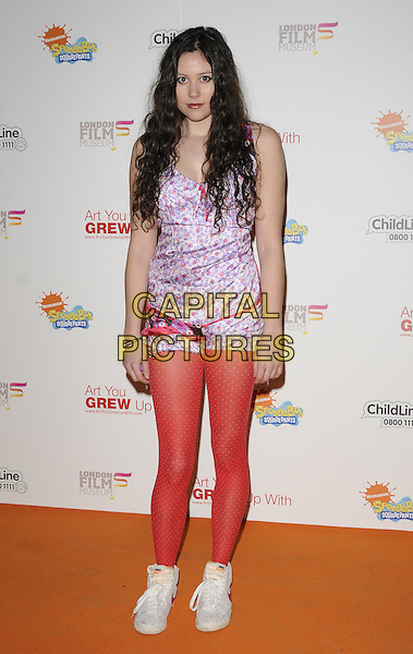 ELIZA DOOLITTLE.Attending the charity auction of SpongeBob SquarePants Artwork, London, England. .January 21st, 2010.full length red tights purple print trainers white pattern top shorts playsuit floral polka dot nike.CAP/CAN.©Can Nguyen/Capital Pictures.