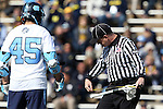 06 February 2016: North Carolina's Chris Cloutier (CAN) (45) watches Referee #19 (right) measure his stick after his first goal. The University of North Carolina Tar Heels hosted the University of Michigan Wolverines in a 2016 NCAA Division I Men's Lacrosse match. UNC won the game 20-10.