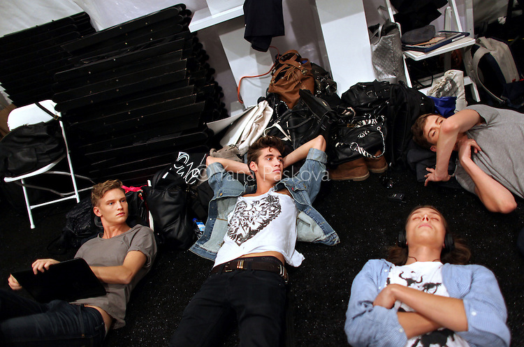 Models rest before the Adrienne Vittadini show at Mercedes-Benz Spring 2011 Fashion Week in the Lincoln Center on Wednesday, September 15, 2010.