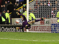 Craig Samson saves the penalty from Cameron Smith to win in the Aberdeen v St Mirren Scottish Communities League Cup match played at Pittodrie Stadium, Aberdeen on 30.10.12.