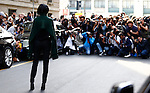 Yoyo Cao poses for street style photographers at the Salvatore Ferragamo show during Milan Fashion Week Women's wear Spring/Summer 2016, in Milan on September 27, 2015.