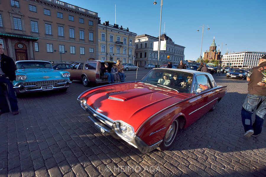During summer from June to Septemper, every first Friday of the month is Vintage Car Cruising Night. Hundreds of classic American cars cruise around downtown Helsinki and meet at special places to have a good time, here at Kauppatori (Market Square), Uspenski orthodox cathedral in background. 1961 Ford Thunderbird hardtop.