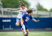 NWA Democrat-Gazette/CHARLIE KAIJO Southside High School Emily Forsgren (5) collides with Rogers High School midfielder Grace Carrol (20) as she heads the ball during the semifinals of the 7A Girls State Soccer Tournament, Saturday, May 12, 2018 at Whitey Smith Stadium at Rogers High School in Rogers. Rogers advanced to the finals when midfielder Skylurr Patrick (3) scored both of Rogers' goals defeating Southside High School, 2-1.
