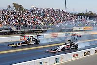 Jul 31, 2016; Sonoma, CA, USA; NHRA top fuel driver Steve Torrence (right) races alongside Tony Schumacher during the Sonoma Nationals at Sonoma Raceway. Mandatory Credit: Mark J. Rebilas-USA TODAY Sports