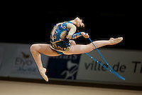 Stefanie Carew of Canada stag leaps with rope during All-Around competition at 2006 Thiais Grand Prix in Paris, France on March 25, 2006.  (Photo by Tom Theobald)
