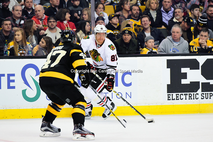 Friday, January 20, 2017: Chicago Blackhawks right wing Marian Hossa (81) looks for a passing lane around Boston Bruins defenseman Torey Krug (47) during the National Hockey League game between the Chicago Blackhawks and the Boston Bruins held at TD Garden, in Boston, Mass. Chicago defeats Boston 1-0 in regulation time. Eric Canha/CSM
