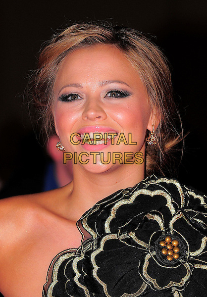 KIMBERLEY WALSH (Girls Aloud).The Pride of Britain Awards, Grosvenor House, Hotel, Park lane, London, England. .October 5th, 2009.headshot portrait black gold flower carrie corsage kimberly one shoulder.CAP/BEL.©Tom Belcher/Capital Pictures.