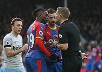 Crystal Palace's Aaron Wan-Bissaka and Luka Milivojevic have words with referee Craig Pawson<br /> <br /> Photographer Rob Newell/CameraSport<br /> <br /> The Premier League - Saturday 9th February 2019  - Crystal Palace v West Ham United - Selhurst Park - London<br /> <br /> World Copyright © 2019 CameraSport. All rights reserved. 43 Linden Ave. Countesthorpe. Leicester. England. LE8 5PG - Tel: +44 (0) 116 277 4147 - admin@camerasport.com - www.camerasport.com
