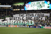 Fans of the Seattle Sounders FC hold up a huge banner. The Seattle Sounders FC defeated the Columbus Crew 2-1 during the US Open Cup Final at Qwest Field in Seattle,WA, on October 5, 2010.