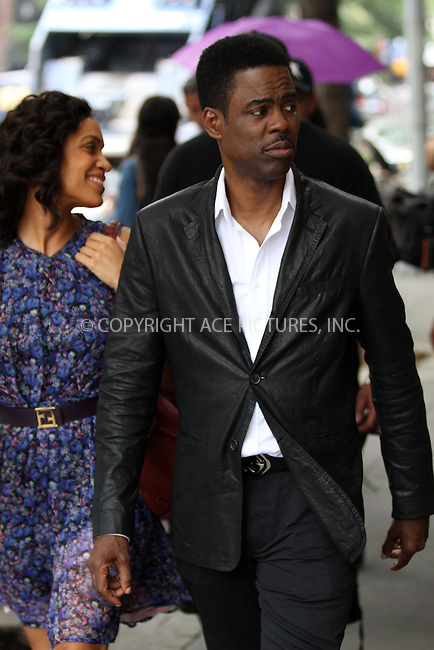 WWW.ACEPIXS.COM<br /> <br /> June 27 2013, New York City<br /> <br /> Actors Rosario Dawson and Chris Rock on the set of Chris Rock's new movie project on June 27 2013 in New York City<br /> <br /> By Line: Zelig Shaul/ACE Pictures<br /> <br /> <br /> ACE Pictures, Inc.<br /> tel: 646 769 0430<br /> Email: info@acepixs.com<br /> www.acepixs.com
