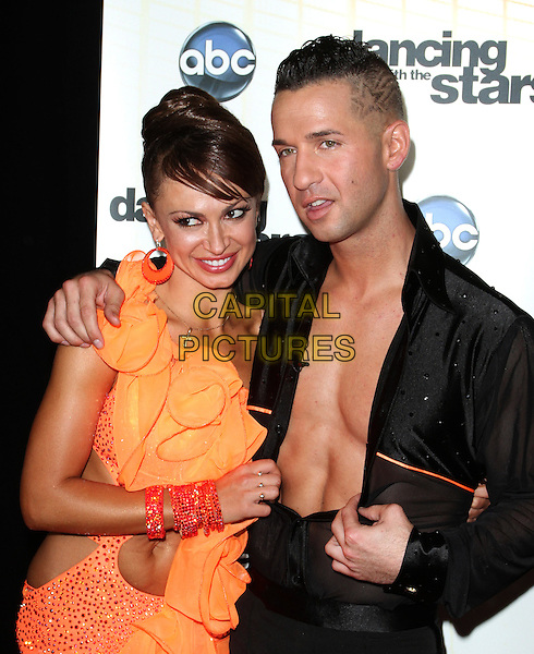 "KARINA SMIRNOFF & MIKE 'THE SITUATION' SORRENTINO.""Dancing With The Stars"" Season Premiere held at CBS Studios, Los Angeles, CA, USA..September 20th, 2010.half length black shirt chest orange dress ruffle arm over shoulder .CAP/ADM/KB.©Kevan Brooks/AdMedia/Capital Pictures."