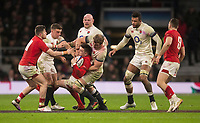 Wales' Josh Adams is tackled by Englands' Joe Launchbury<br /> <br /> Photographer Bob Bradford/CameraSport<br /> <br /> NatWest Six Nations Championship - England v Wales - Saturday 10th February 2018 - Twickenham Stadium - London<br /> <br /> World Copyright &copy; 2018 CameraSport. All rights reserved. 43 Linden Ave. Countesthorpe. Leicester. England. LE8 5PG - Tel: +44 (0) 116 277 4147 - admin@camerasport.com - www.camerasport.com