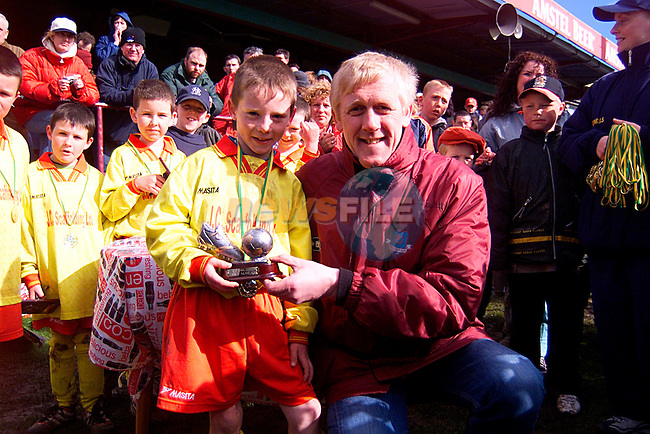 Harry McCrue with Man of The Match from Grove Rangers...Pic Newsfile